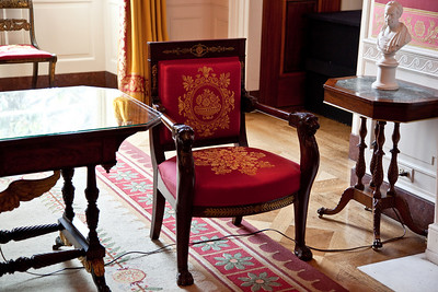 The Red Room is one of three state parlors on the first floor in the White House. The room has served as a parlor and music room, and recent presidents have held small dinner parties in it. It has been traditionally decorated in shades of red. Most furniture presently found in the Red Room, though antique, was acquired during the Kennedy and Nixon administrations. The furniture was upholstered in cerise red silk of the same shade as that on the walls with a pattern of gold medallions, scrolls, and fruit basketscopied from an early 19th century French document.