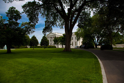 View of the White House North Portico and North Lawn. Because it is bordered by Pennsylvania Avenue, the White House's official street address, the North Lawn is sometimes described as the front lawn. Washington DC - May 7, 2010.