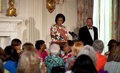 Michelle Obama looks to her own mother, Marian Robinson, at a Mother's Day tea at the White House in Washington DC on May 7, 2010. The event included former first lady Rosalynn Carter and granddaughter, Sarah Carter; President Richard Nixon's daughter Tricia Nixon Cox; and President Dwight D. Eisenhower's granddaughters Susan and Anne Eisenhower, along with young women who participate in Mrs. Obama's mentoring program, spouses and mothers of service members, and Vice President Joe Biden's wife, Jill. (Photo by Jeff Malet)