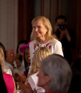 Michelle Obama acknowledged President Richard Nixon's daughter Tricia Nixon Cox at a Mother's Day Tea in the State Dining Room of the White House on May 7, 2010. The event included former first lady Rosalynn Carter and granddaughter, Sarah Carter; and President Dwight D. Eisenhower's granddaughters Susan and Anne Eisenhower, along with young women who participate in Mrs. Obama's mentoring program, spouses and mothers of service members, and Vice President Joe Biden's wife, Jill. (Photo by Jeff Malet)