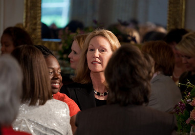 President Dwight D. Eisenhower's granddaughter Anne Eisenhower (center) attends a Mother's Day Tea in the State Dining Room of the White House hosted by Michelle Obama on May 7, 2010. The event included former first lady Rosalynn Carter and granddaughter, Sarah Carter; another of President Dwight D. Eisenhower's granddaughters Susan Eisenhower and President Richard Nixon's daughter Tricia Nixon Cox along with young women who participate in Mrs. Obama's mentoring program, spouses and mothers of service members, and Vice President Joe Biden's wife, Jill. (Photo by Jeff Malet)