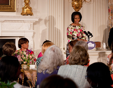 Michelle Obama paid tribute to her mother, Marian Robinson (seated left), at a Mother's Day Tea in the State Dining Room of the White House on May 7, 2010. The event included former first lady Rosalynn Carter and granddaughter, Sarah Carter; President Richard Nixon's daughter Tricia Nixon Cox; and President Dwight D. Eisenhower's granddaughters Susan and Anne Eisenhower, along with young women who participate in Mrs. Obama's mentoring program, spouses and mothers of service members, and Vice President Joe Biden's wife, Jill. (Photo by Jeff Malet)