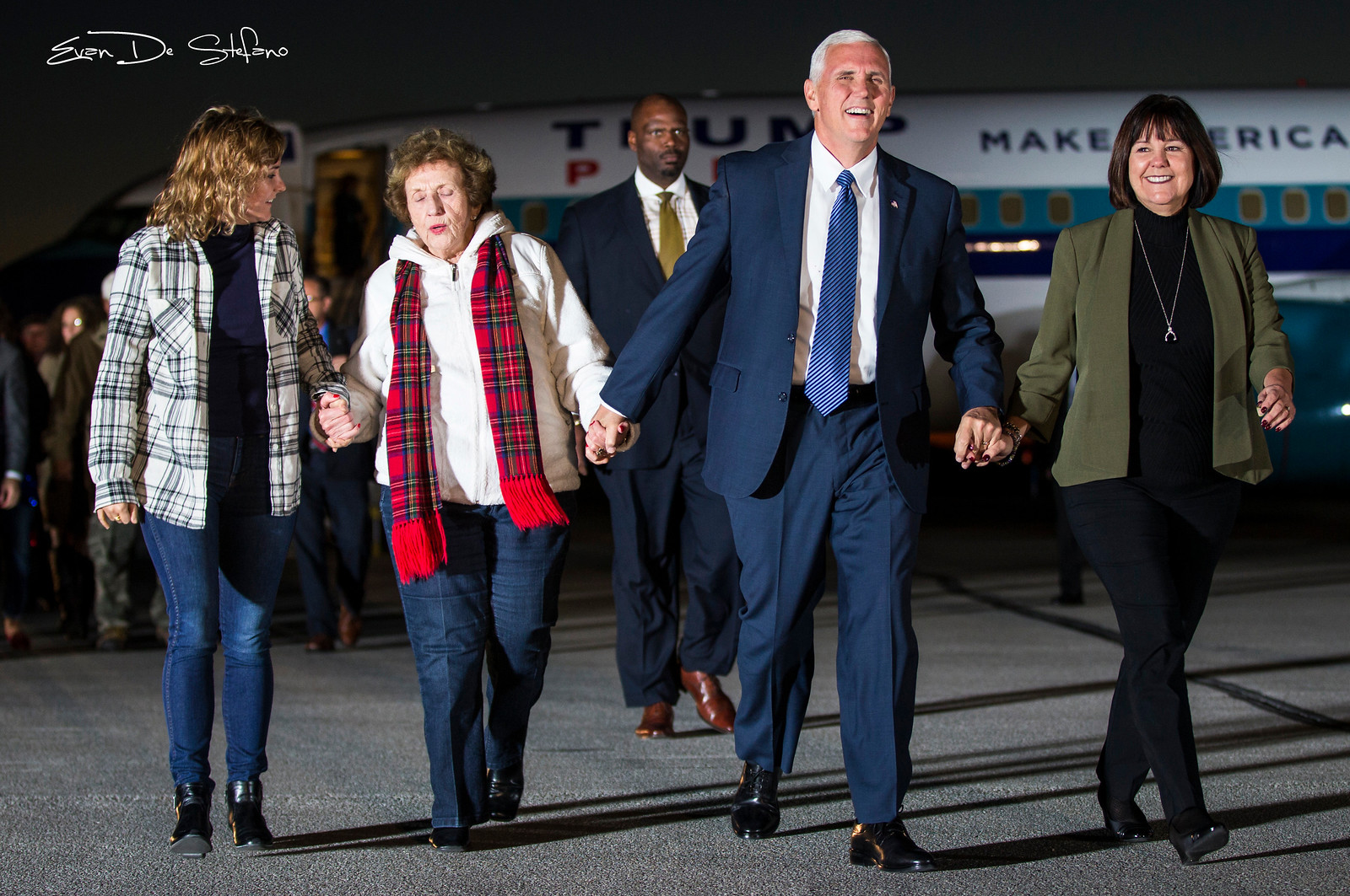 Vice President-Elect Mike Pence and wife Karen Pence (right), mother Nancy Pence (middle), and daughter Charlotte Pence (right) walk towards the crowd of supporters at the Indianapolis Airport on November 10, 2016. Photo/ Evan De Stefano