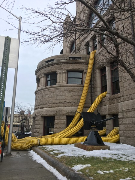 Commercial dehumidifiers pumped hot, dry air into the Pollard Memorial Library and sucked moisture out Thursday following a burst pipe over the weekend that caused an estimated $350,000 in damages. SUN / ALANA MELANSON