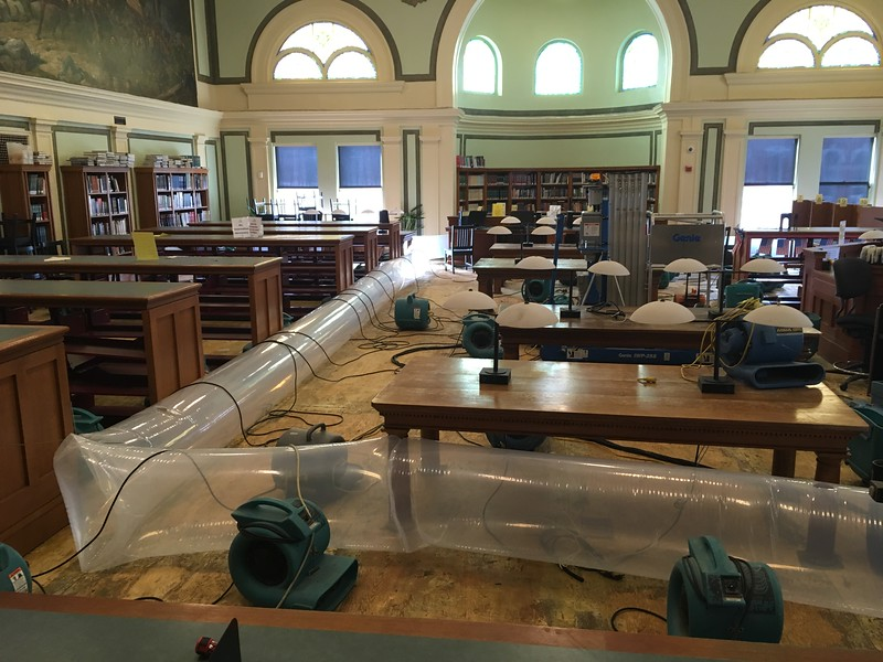 Turbo drier fans whirred on the second floor of the Pollard Memorial Library Thursday, part of the drying process after 5,000 gallons of water were dumped through each floor of the building thanks to a burst pipe over the weekend.  SUN / ALANA MELANSON