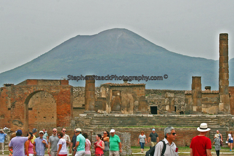 Ancients ruins of Pompeii with Mount Vesuvius in the background.