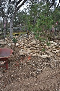 Beginning of the dry creek bed constructed of rocks removed from the fill.