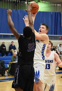 Royal Oak freshman Jesse Hoisington puts up a shot over Pontiac senior Cleontai Brown (30) during the first half Tuesday night. (Digital First Media photo by Jason Schmitt)