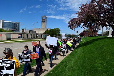 Protesters rally around Pontiac City Hall to support immigrant rights on Monday, May 1, 2017.