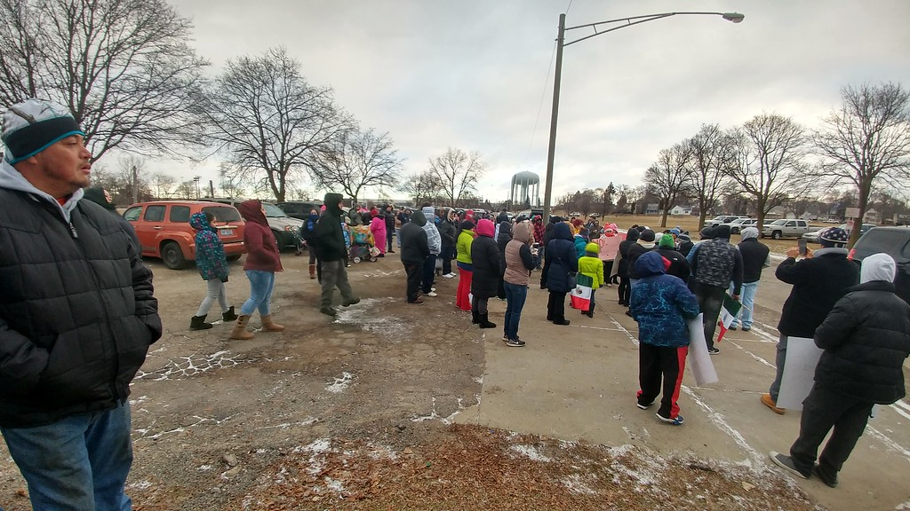 . Hundreds of people gather in the parking lot next to Creative Employment Opportunities, 345 Edison St. in Pontiac for the �A Day Without Immigrants� rally taking place across the nation on Thursday, Feb. 16, 2017.