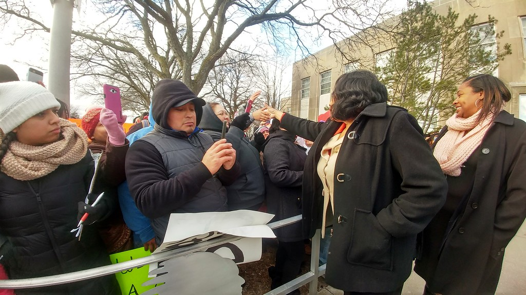 . Pontiac Mayor Deirdre Waterman greets the crowd after hundreds of people marched from Edison Street to City Hall, chanting for the mayor to come outside upon arrival, in Pontiac on Thursday, Feb. 16, 2017.