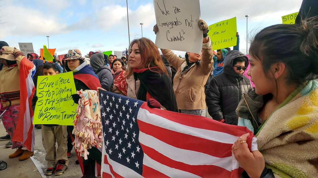 . Hundreds of people marched through downtown Pontiac to City Hall for the �A Day Without Immigrants� rally taking place across the nation on Thursday, Feb. 16, 2017.