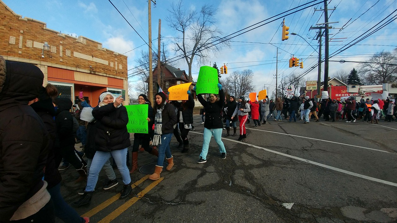 """Hundreds of people march through downtown Pontiac for the """"A Day Without Immigrants"""" rally taking place across the nation on Thursday, Feb. 16, 2017."""