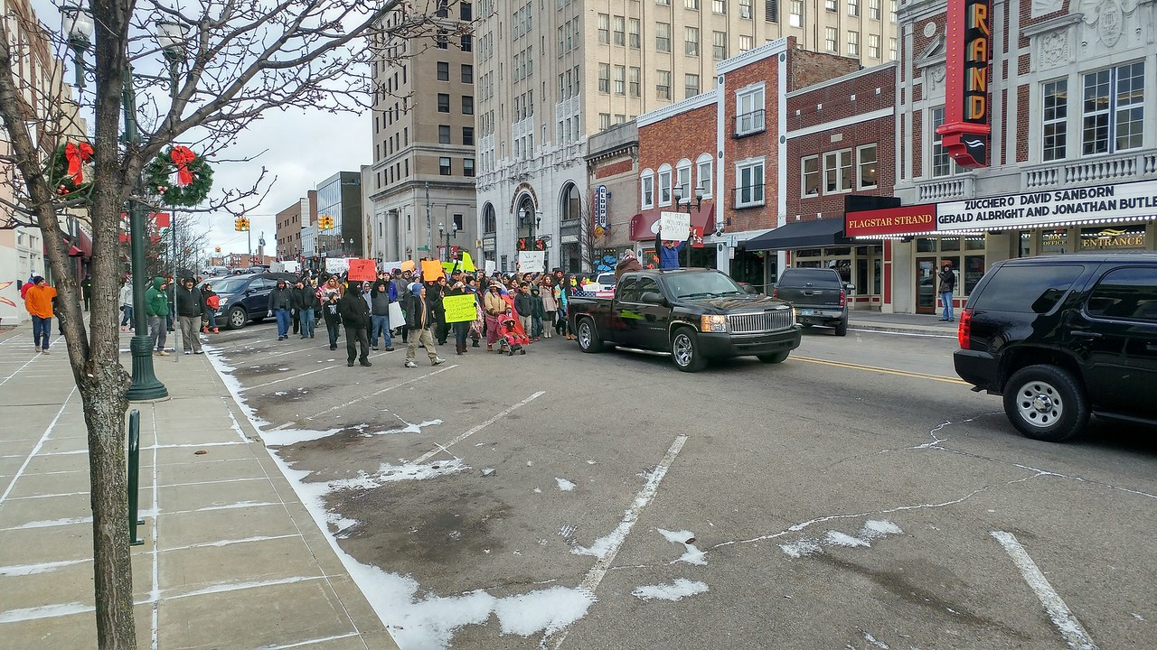 """Hundreds of people marched through downtown Pontiac to City Hall for the """"A Day Without Immigrants"""" rally taking place across the nation on Thursday, Feb. 16, 2017."""