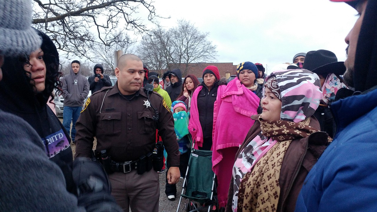 """Hundreds of people gather in the parking lot next to Creative Employment Opportunities, 345 Edison St. in Pontiac for the """"A Day Without Immigrants"""" rally taking place across the nation on Thursday, Feb. 16, 2017."""
