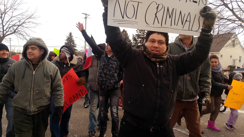 . Hundreds of people march through downtown Pontiac for the �A Day Without Immigrants� rally taking place across the nation on Thursday, Feb. 16, 2017.