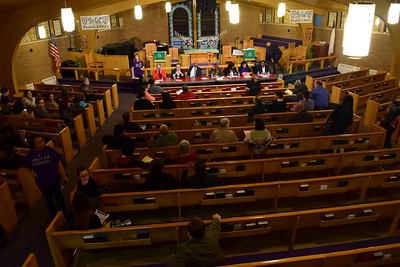 "Educators, parents and concerned citizens mingle at the ""Save Our Public Schools"" community meeting at Newman A.M.E. Church, 233 Bagley St. in Pontiac on Tuesday, Feb. 28, 2017."