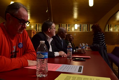 "Rick Trainor (left), secretary and treasurer of the Michigan Education Association sits beside Steve Cook, president of the Michigan Education Association and Donald Weatherspoon, consultant to the Pontiac superintendent at the ""Save Our Public Schools"" community meeting at Newman A.M.E. Church, 233 Bagley St. in Pontiac on Tuesday, Feb. 28, 2017."