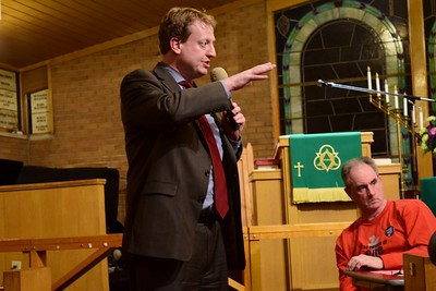 "State Rep. Tim Greimel speaks to the crowd at the ""Save Our Public Schools"" community meeting at Newman A.M.E. Church, 233 Bagley St. in Pontiac on Tuesday, Feb. 28, 2017."