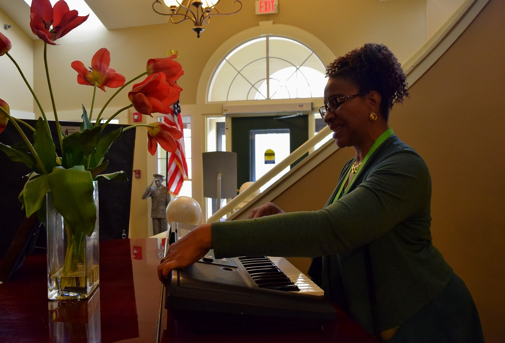 . Carlotta Quince, English language arts teacher at Great Lakes Academy, sets up the piano at the American House Oakland Senior Living Facility in Auburn Hills on Monday, May 15, 2017.