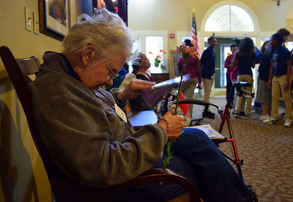 . Sixth graders from Great Lakes Academy in Pontiac pass out flowers and gifts to seniors at the American House Oakland Senior Living Facility in Auburn Hills on Monday, May 15, 2017.