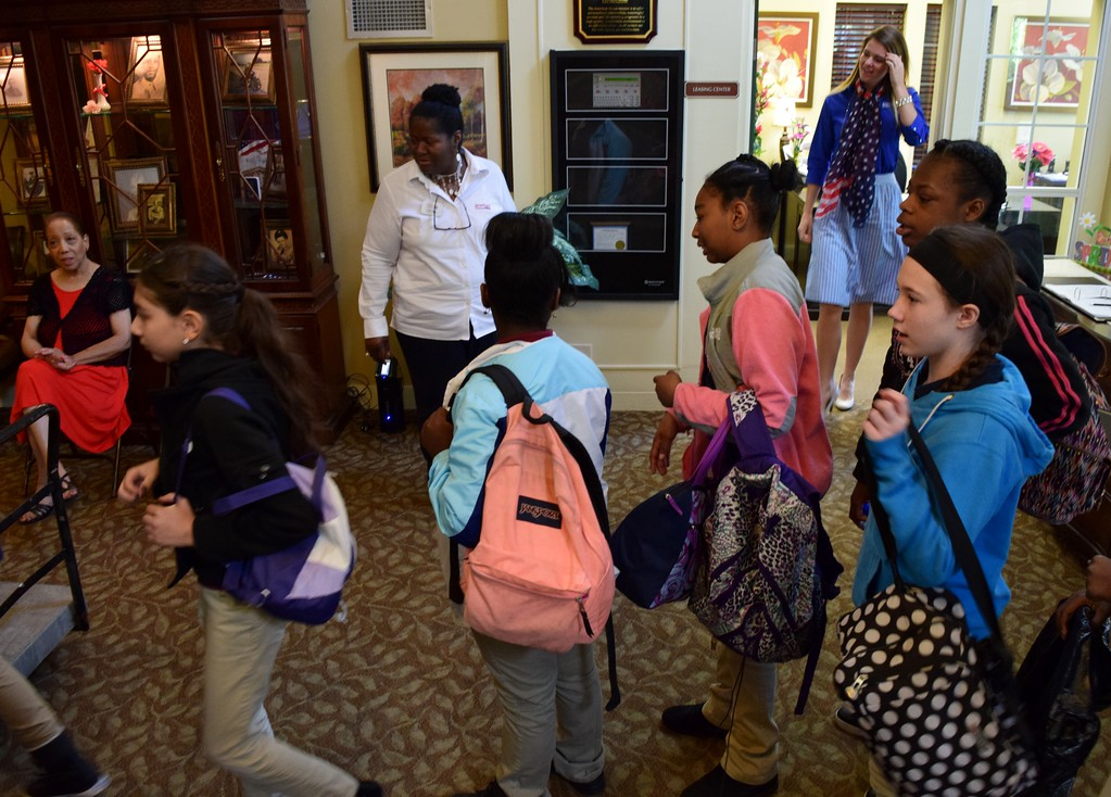 . Sixth graders from Great Lakes Academy in Pontiac setting up to spend the day with seniors at the American House Oakland Senior Living Facility in Auburn Hills on Monday, May 15, 2017.
