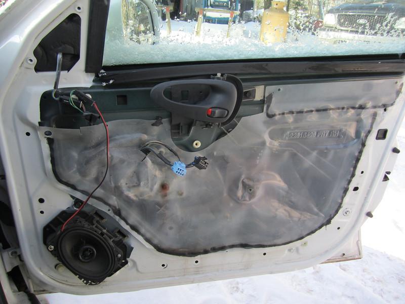 Passenger side - Door panel removed.  Factory speaker shown