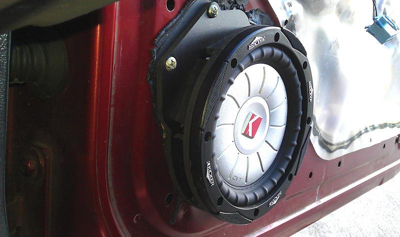 "Aftermarket speaker and speaker adapter brackets   from  <a href=""http://www.car-speaker-adapters.com/items.php?id=SAK055""> Car-Speaker-Adapters.com</a>   installed on door"