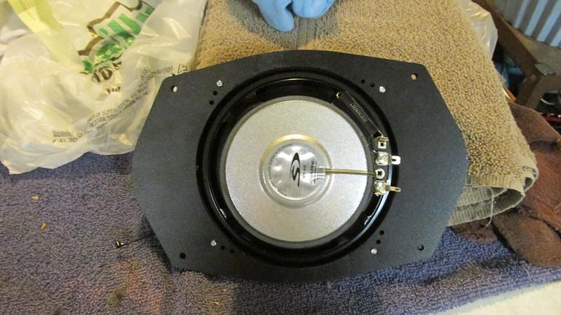"Aftermarket speaker mounted to speaker adapter  from  <a href=""http://www.car-speaker-adapters.com/items.php?id=SAK045""> Car-Speaker-Adapters.com</a>   (rear view)"
