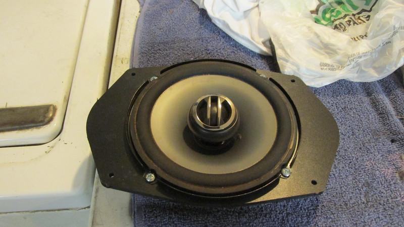 "Aftermarket speaker mounted to speaker adapter   from  <a href=""http://www.car-speaker-adapters.com/items.php?id=SAK045""> Car-Speaker-Adapters.com</a>"