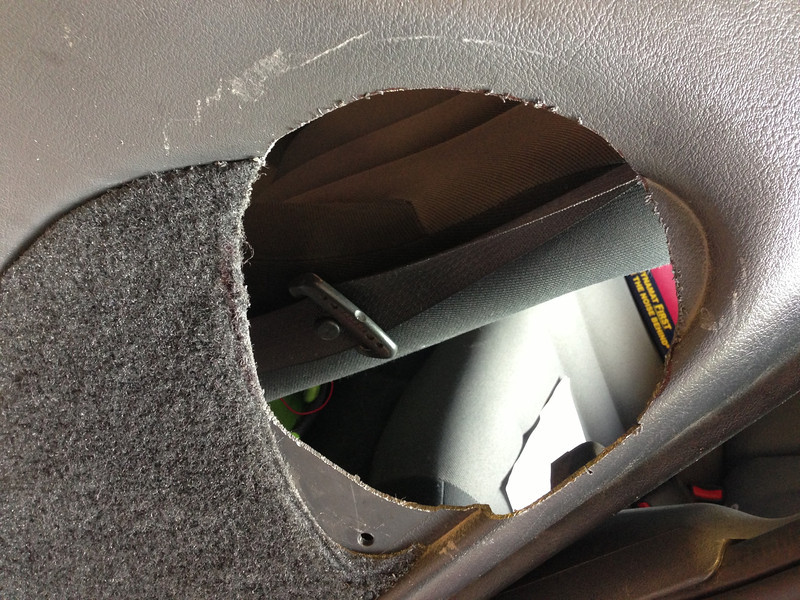 Door panel cut for speaker grills