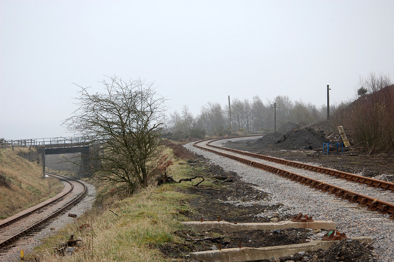 Mainline of the left diving under the rail over rail bridge, Big Pit branch clims away to the right (joining the line over the bridge).