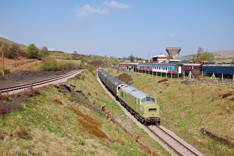 37216 leads the first train of the day down the hill past the exchange sidings