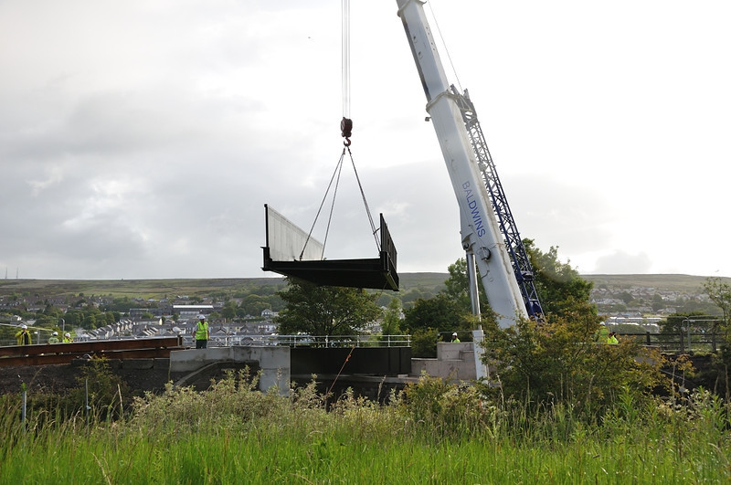The cycle track bridge is lifted into place