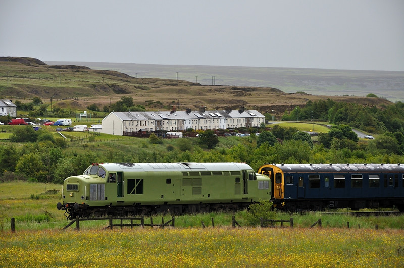 It's a dull start to the day as 37216 passes the Garn Terraces
