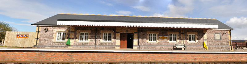 A photo shopped merge compiled from 3 pictures to show the new station building and the superb stone front.