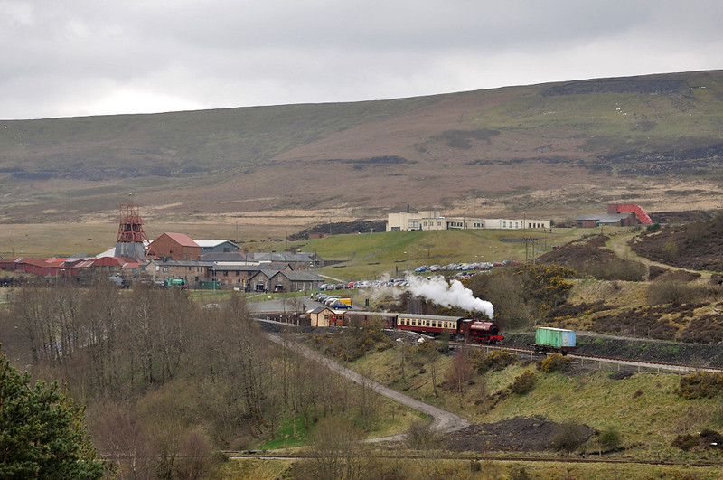 The view from the far side of the valley, with Big Pit halt and Big Pit in view. 71515 heads a departing train, the container wagon is on the rail over rail bridge track.