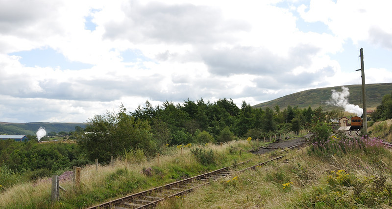 on the left the mainline trains heads up the hill from Blaenavon, on the right the branch train departs Big Pit