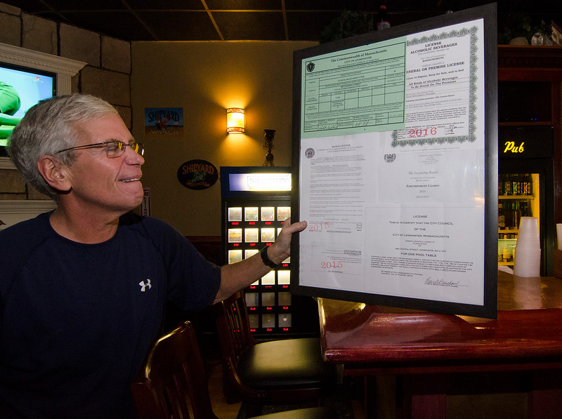 Owner Andy Rome shows off the newly-acquired license for a pool table at Classic's Pub in Leominster. SENTINEL & ENTERPRISE / Ashley Green
