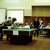 Mike Massey shooting in the finals of the 1980 BCA National 8 Ball Championship. Mike finished second to Nick Varner, who is seated in this photo. Conrad Burkman, in the suit, is a referee.