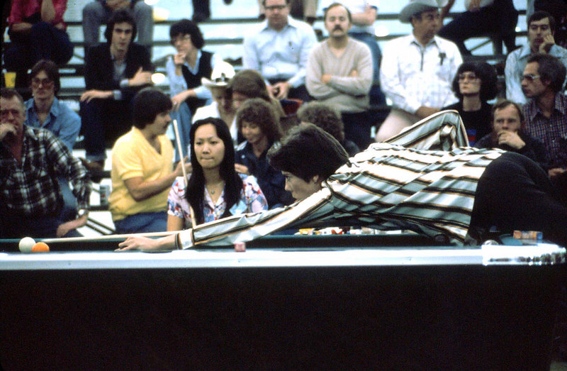 Mary Kenniston shooting while Cathy Miao watches - Mary was shooting well and won the woman's tournament.