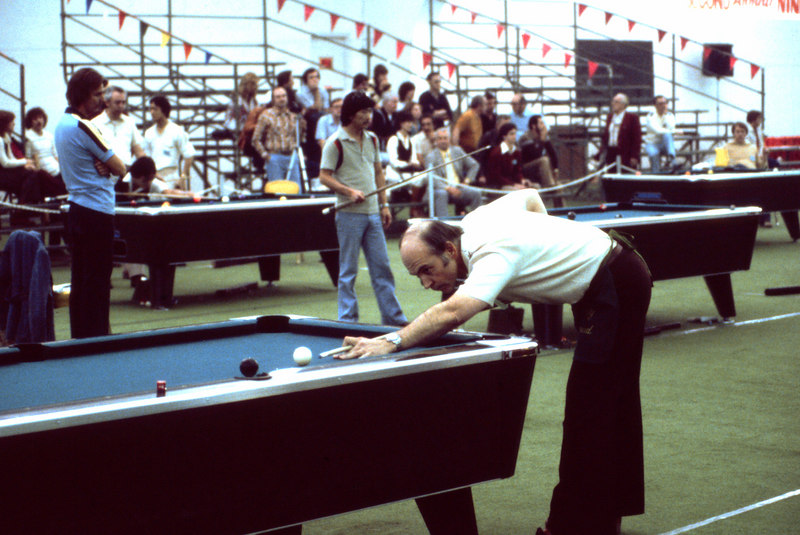 Bill Stroud shooting pool, but not at the Rocky Mountain Open. This shot was taken at the Las Vegas Open in 1980.
