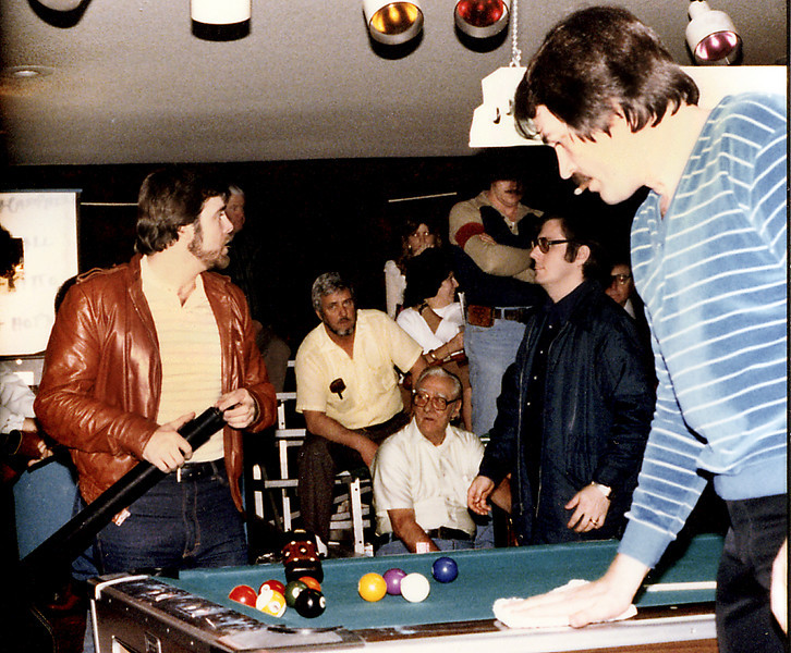 Benny Conway cleans the table as Allen Hopkins stands nearby.