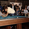 "Buddy Hall<br /> <br /> Buddy isn't trying to use the 5 ball as a cue  ball, he is probably planning a stop shot on the five and looking at his six ball shot if the cue ball replaces the five ball.<br /> <br /> The reason that the spectators aren't looking at the ""action"" in this photo and several others is that I was using a flash for these shots and none of them are actual action shots during matches."
