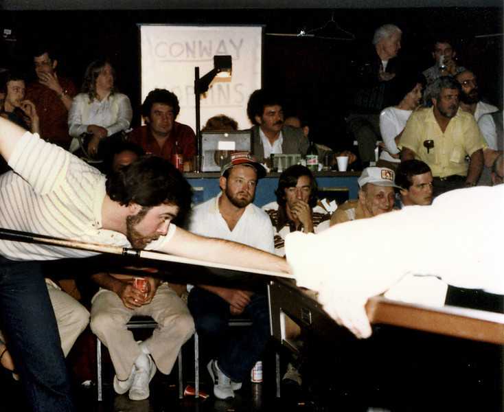 "Allen Hopkins - I have no idea what caused the irregular white area to the right of the image. I thought about discarding this image, but then I thought about the guy in the while shirt on the front row. Wouldn't he want me to put this image in the gallery? An AZ Billiards poster (JG-in-KY) wrote that he was, ""99% sure the guy in between the two guys with hats in the front row is Frank Fisher. He is wearing the striped shirt with his eyes closed in the one photo. Frank was a fine player and even made some cues at one time. Last I heard he resided in Johnson City, Tennessee."""