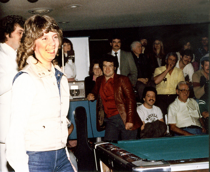 Mike Massey is just behind the young lady in the foreground. Bill Stigall (sp?) in the leather jacket and Butch Baker, a strong Cincinnati player, in the white t-shirt on the front row.
