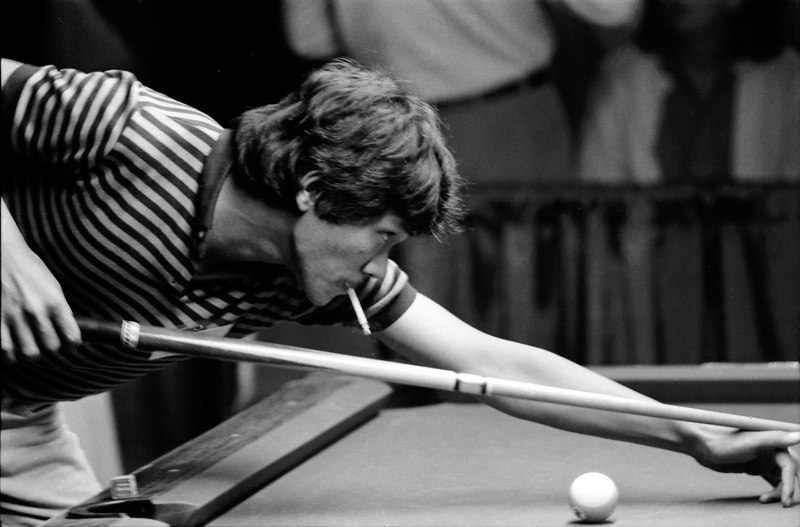 Efren Reyes - This shot of Efren smoking while shooting is probably a one-of-a-kind.