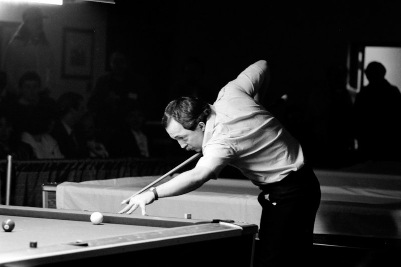 Gary Spaeth jacks up to shoot a bank. Bet he made it! This was a cover shot for Billiard News.