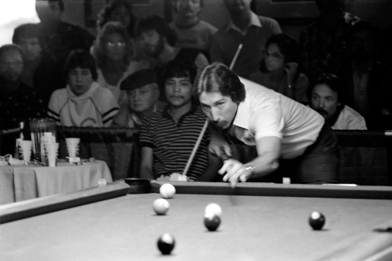 "David Howard shoots as Efren Reyes watches. This is one of those shots that really captures the ""feel"" of this old tournament."