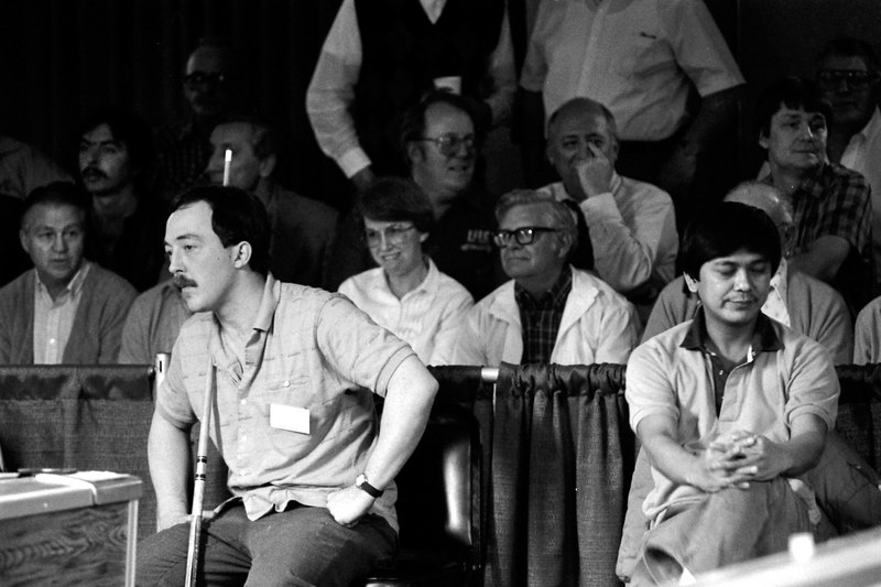 Gary Spaeth on left as Jose Paria rests his eyes. Can you find Steve Mizerak in the stands? Hint: He's wearing glasses and looking to his left.